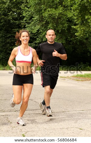 Two fit people out for a jog