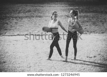Two fitness girl with yoga mat outdoor in nature. Fit woman with exercise accessory in summertime landscape #1273246945
