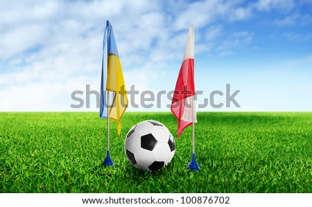 two flag and  football on grass - stock photo