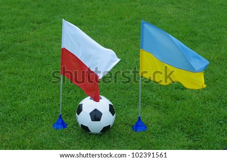 two flag and  football on grass