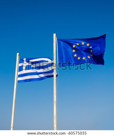 Two flags are developed in the wind, Greece and the EU .