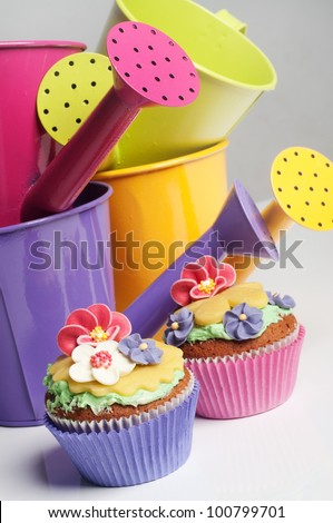 Two floral cucakes in a spring setting