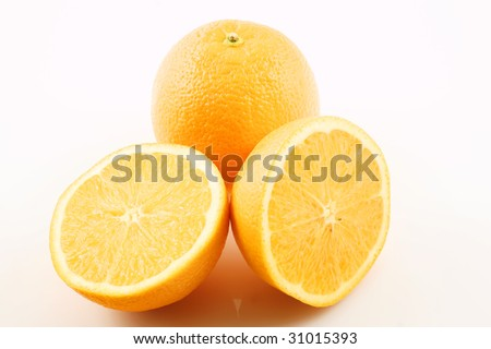 two florida orange halves with whole in back