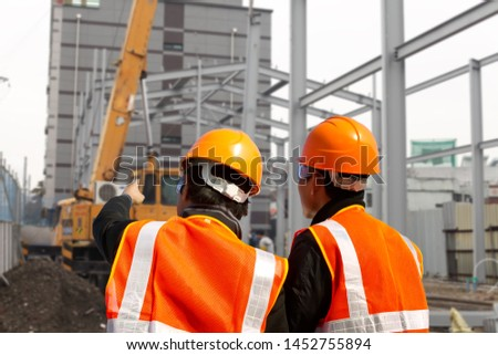 two foreman discussion on construction site