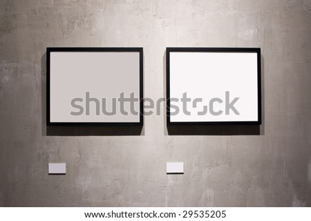 Two frames on cement wall