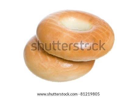 Two Fresh and Healthy Bagels Isolated on a White Background - stock photo