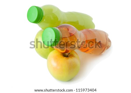 Two fresh apples and two bottles of apple juice. On white background.