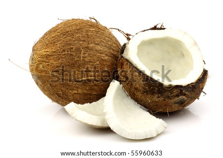 two fresh coconuts and one opened on a white background - stock photo