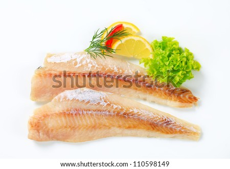 Two fresh fish fillets on a white background