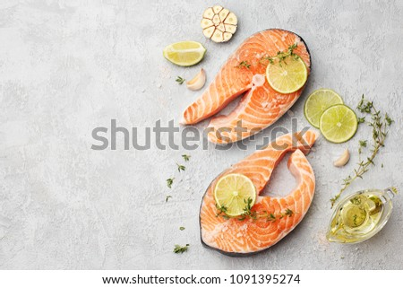 ee407fb2c3ae Two fresh raw salmon steaks with lime