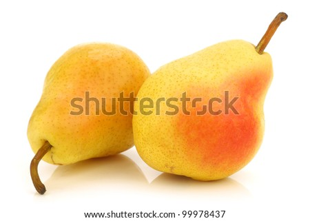 Two fresh Williams pears on a white background