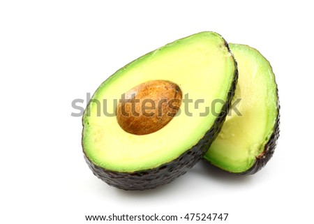 Two freshly cut avocado halves laying side by side on a white background