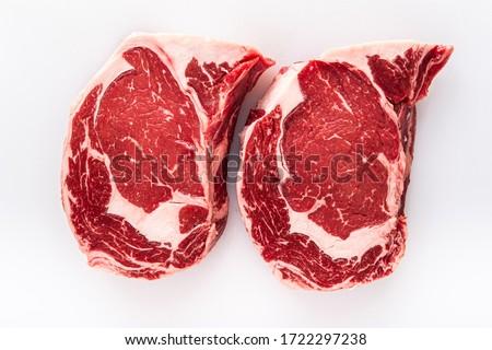 Two freshly cut boneless ribeye steaks on a butchers table Stock photo ©
