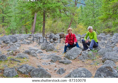 Two friendly female tourists on Remote Camp trail at Stein Valley Heritage Park in British Columbia, Canada.