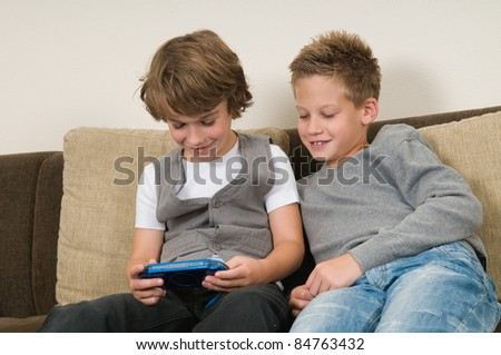 Two friends are playing a computer game on a gaming console