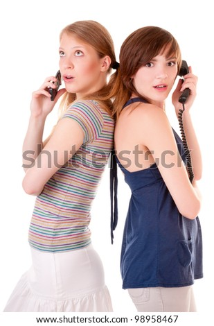 Two friends communicate by phones isolated on white background