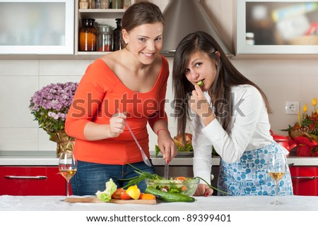 two friends cooking together