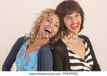 Two friends dressed fashionably / Two friends laughing