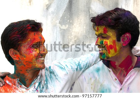 Two friends enjoying the colorful holi festival in India.