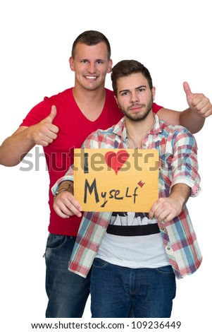 Two Friends Enjoying Time Together And Holding Sign Saying I Love Myself