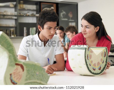 Two friends experimenting in lab together