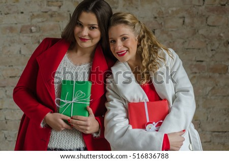 two friends hold gifts in hand...