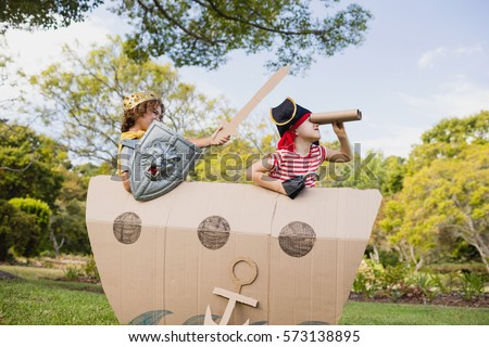 Two friends playing and dressing up in the park