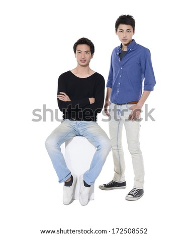 two friends standing and sitting cube on white background