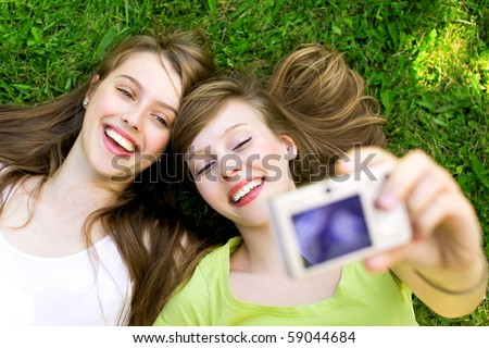 Two friends taking pictures