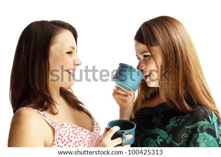 Two friends talking, drinking tea and laughing