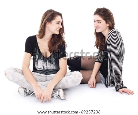 Two friends talking to each other. The image is isolated on a white background.