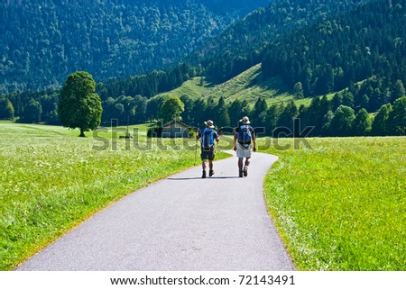Two friends travel together to mountains