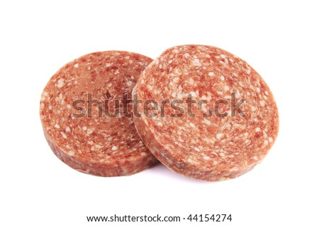 Two frozen hamburger patties isolated on white background