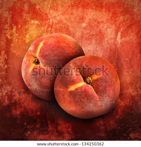 Two fruit peaches are isolated on a bright orange textured background with rough areas.