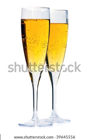 Two full champagne flutes isolated on white background