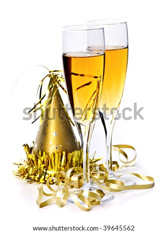 Two full champagne flutes with party hat and ribbon isolated on white background