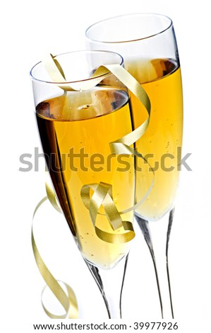 Two full champagne flutes with sparkling wine and ribbon isolated