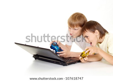 Two funny boys with laptop on a white background