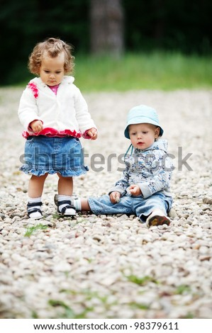 two funny children in park