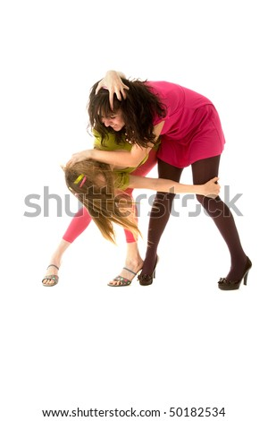 Two funny girls fighting and laughing