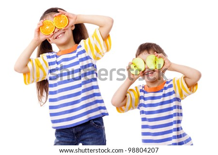 Two funny kids with fruits on face, isolated on white
