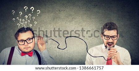 Two funny looking business men having troubled communication
