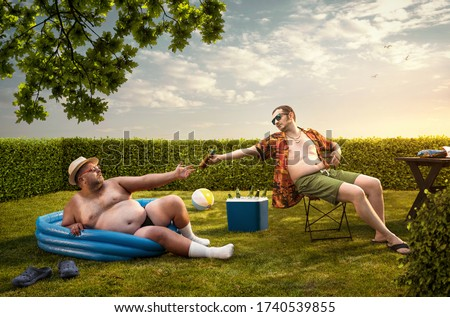 Two funny nerds relaxing in the backyard on the summer day Stock foto ©