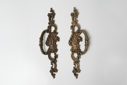 two furniture antique handles, bronze furniture handles on a white background, handles for vintage furniture, knobs from antique furniture