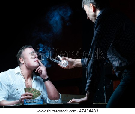 Two gamblers with cards, spill out liquid in face