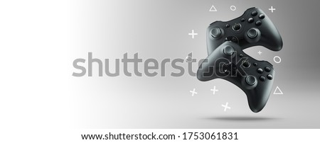 Two gamepads on a light background.