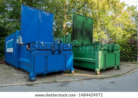 two garbage compactors Standing next to each other on the premises of a hospital Foto stock ©