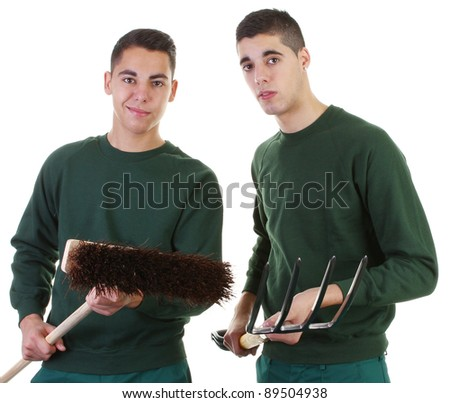 Two gardeners one with a broom the other with a fork