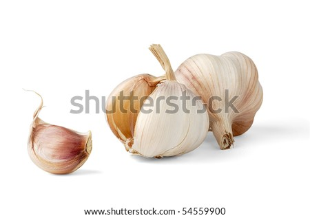 Two garlic heads and one segment isolated on white