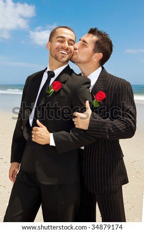stock photo : Two gay grooms kissing. Men in suits.